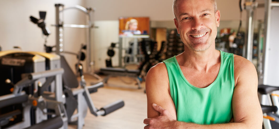 Portrait Of Mature Man Standing In Gym